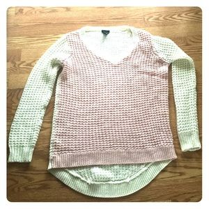 Pink and ivory sweater.