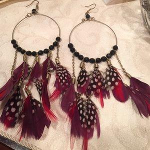 Bebe large feather hoop earrings purple black