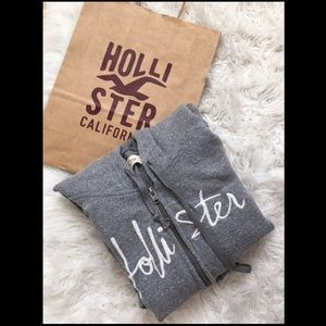 Grey and White zip-up Hollister jacket