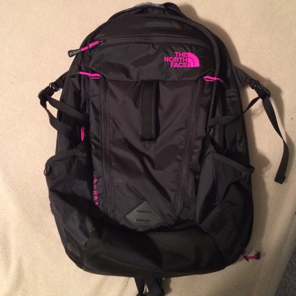 c5684c86d Black North Face Surge Backpack with pink writing