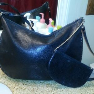 Black leather handbag with smaller pouch attached