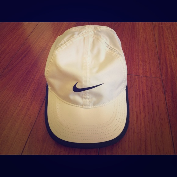 55bac4ed9a9fd Women's Nike Featherlight Dri-Fit White Hat. M_56882dc87fab3aa3b2070a38.  Other Accessories ...