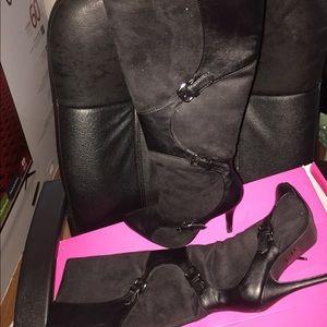 Black mid calf boots .