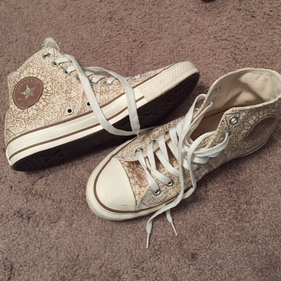 new specials exclusive range highly coveted range of Gold and cream high top converse sneakers
