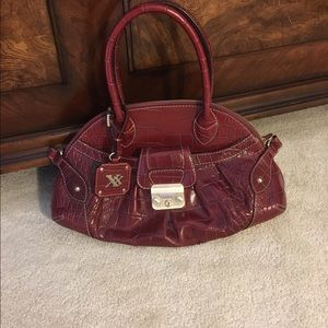 MAXX New York leather tote hand bag/deep red