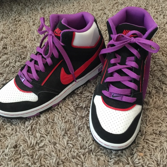 Brand new Nike high top shoes. Black, purple, red