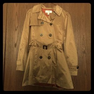 Tan colored trench coat