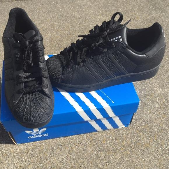Adidas Shoes - All black adidas shell toes 64cc5259b