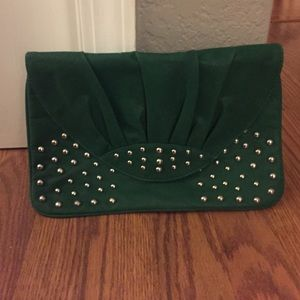 Green stud envelope clutch.