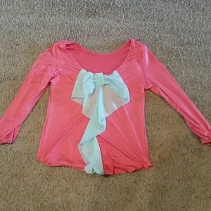 Pink shirt with blue bow