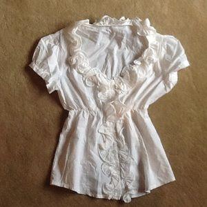 White cotton ruffle blouse.