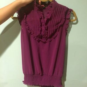 Sheer sleeveless button up blouse