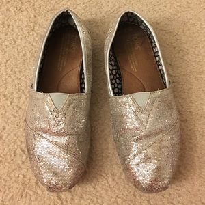 TOMS silver slip on size 7.5