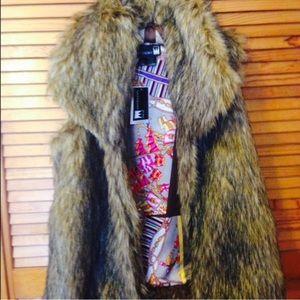 Jackets & Blazers - Faux fur vest by Anthony Design Originals.