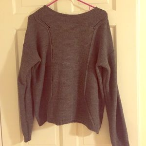 Adorable sweater with back slit