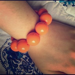 Orange statement bracelet