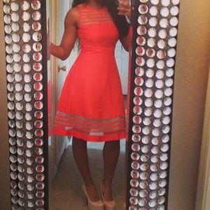 Semi flare knee length tangerine colored dress