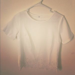 White top with scalloped cut out detailed edge