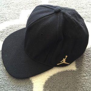 Jordan Accessories - Men s Jordan SnapBack hat color black   gold. 683e323773f