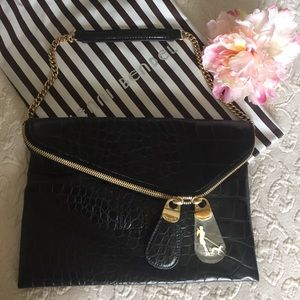 Henri Bendel black clutch bag with strap