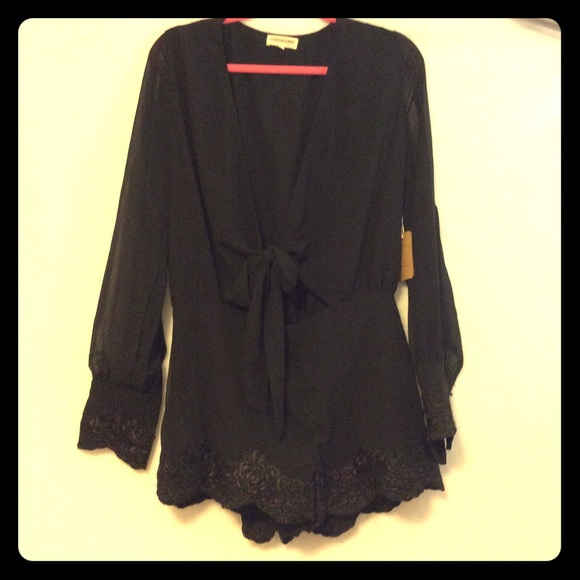 6053c4c95a61 Black silky romper with lace. Short shorts.