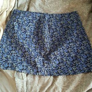 Express Blue floral mini-skirt.98% cotton.11/12
