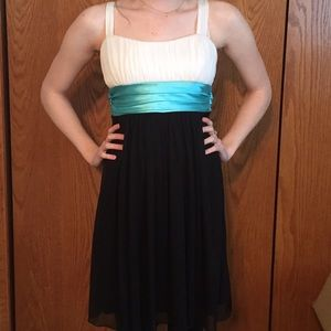 Black and white dress with blue sash