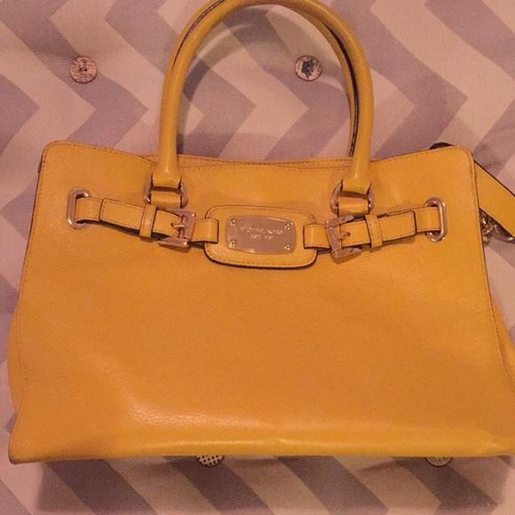 13c5947e0a3100 Michael Kors mustard yellow purse. M_56984a82a88e7d82ec002ef2