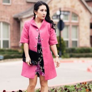 Pink wool coat with funnel neck and swingy hemline
