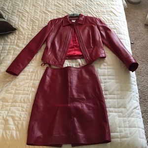 100% Leather. skirt is a size 4.  jacket size 6