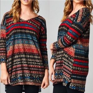 The CASSANDRA tribal print long sleeve top RED