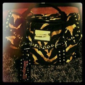 Betseyville leopard print duffel style handbag