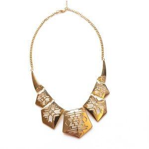 Gold Aztec pattern statement necklace