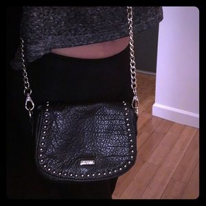 Guess leather cross body bag with studs