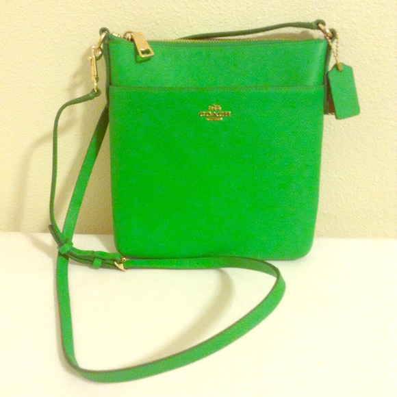 46% off Coach Handbags - Green Coach courier crossbody from ...
