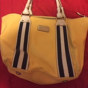 Michael kors purse in yellow