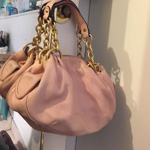 light pink leather Juicy Couture handbag