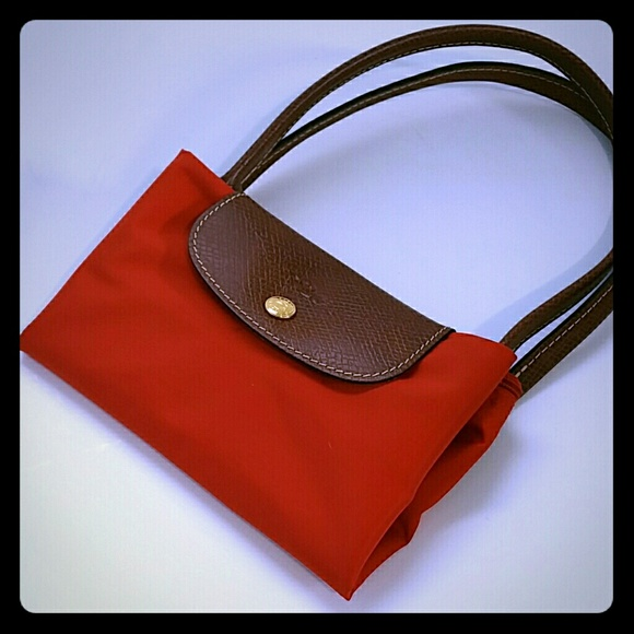 Longchamp Le Pliage small tote in red orange. Listing Price: $90. Your Offer
