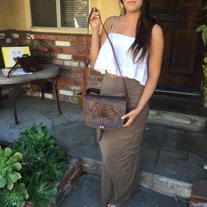 Vintage leather bag with floral detail