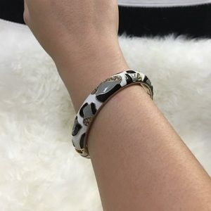 Jewelry - Gold bangle with white black gray animal print