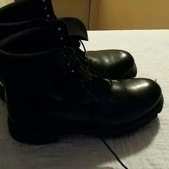 A Pair Of Black Shiny Timberland Boots