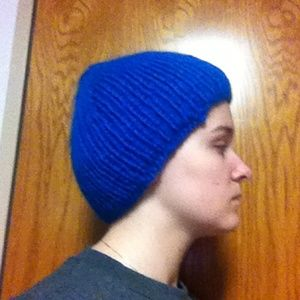 Larger, blue knitted cap