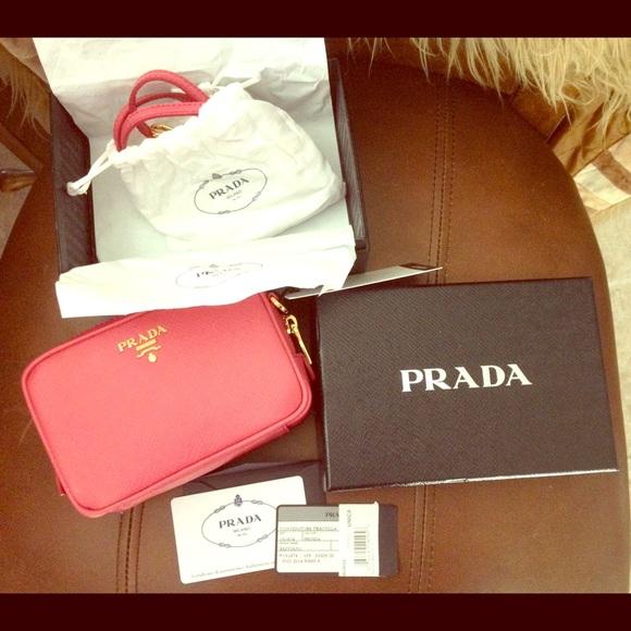 2587c2f3e9ba Authentic Prada Saffiano Mini zip cross body bag