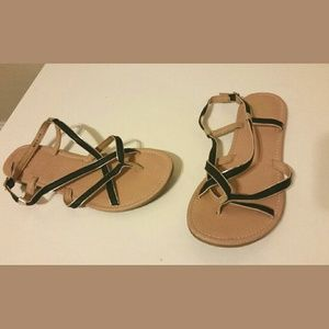 Black and gold strappy sandals.
