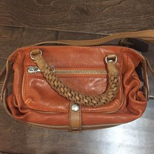 Gryson orange leather handbag w/ woven handles