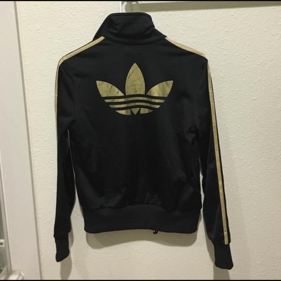 6ad995650a56 Adidas firebird TT black and gold track jacket