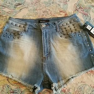 Pants - NWT High waisted.stretch denim cut offs with studs