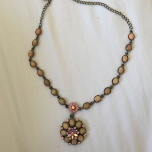 Costume jewelry necklace with pink stone accents