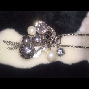 Long necklace with silver tones