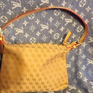 Light brown Dooney & Bourke handbag